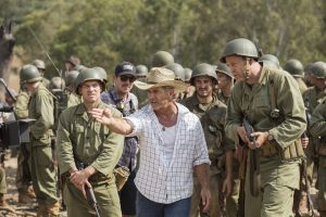 (l-r) Sam Worthington, Director Mel Gibson, and Vince Vaughn on the set of HACKSAW RIDGE. ©Lionsgate. CR: Mark Rogers.