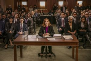 (Front row left to right.) Grace Lynn Jung, Noah Robbins  (Center at desk.) star, Jessica Chastain (Second row  left to right.) Ennis Esmer, Douglas Smith, (Second row fourth to right.) Raoul Bhaneja and (Second row far right.) Sam Waterston star in EuropaCorp's MISS SLOANE. © 2016 EuropaCorp – France 2 Cinema CR: Kerry Hayes