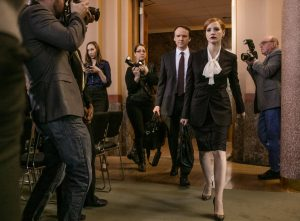 David Wilson Barnes (left) and Jessica Chastain (right) star in MISS SLOANE. ©EuroCorp - France 2 Cinema. CR: Kerry Hayes.