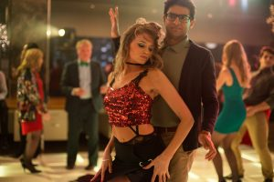 Karan Soni as Nate and Abbey Lee as Savannah in OFFICE CHRISTMAS PARTY. ©Paramount Pictures. CR: Glen Wilson.