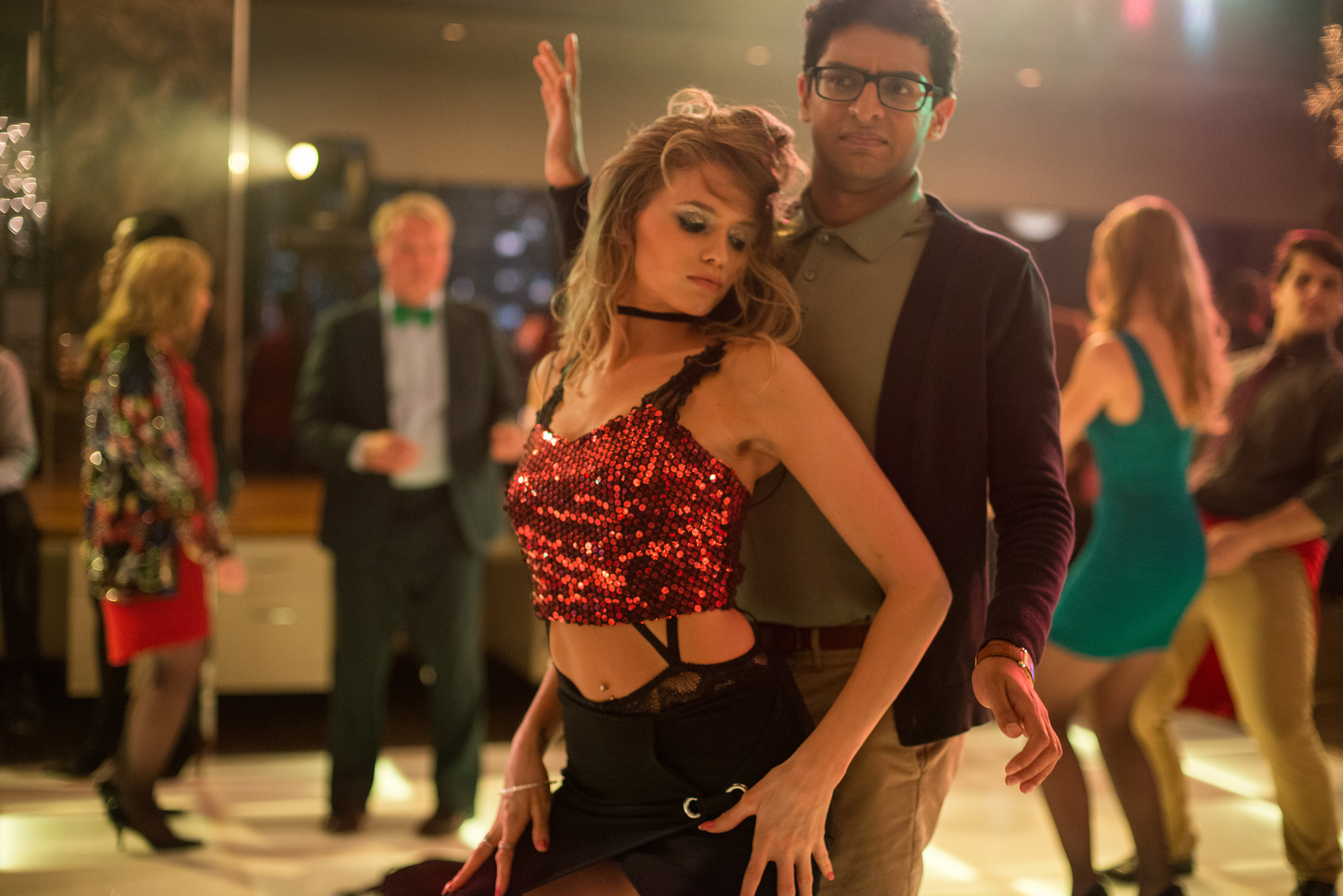 photos be sure to rsvp for office christmas party front row karan soni as nate and abbey lee as savannah in office christmas party ©paramount