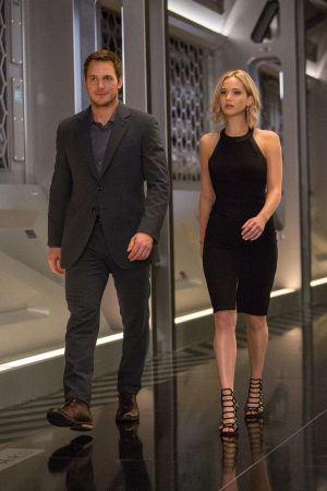 (l-r) Jim (CHRIS PRATT) and Aurora (JENNIFER LAWRENCE) walk thru the Hibernation Bay on date night in Columbia Pictures' PASSENGERS. ©Columbia Pictures. CR: Jaimie Trueblood.