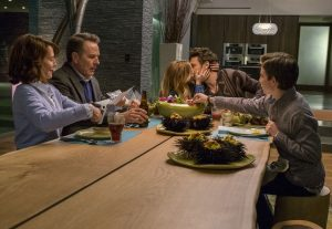 Ned (Bryan Cranston 2nd left) isn't happy when his future son-in-law Laird (James Franco, 2nd right) makes out with his daughter Stephanie (Zoey Deutch 3rd from left) at the dinner table, as Barb (Megan Mullally ,left) and Scotty (Griffin Gluck, right) pretend not to notice in WHY HIM? ©20th Century Fox. CR:. Scott Garfield.